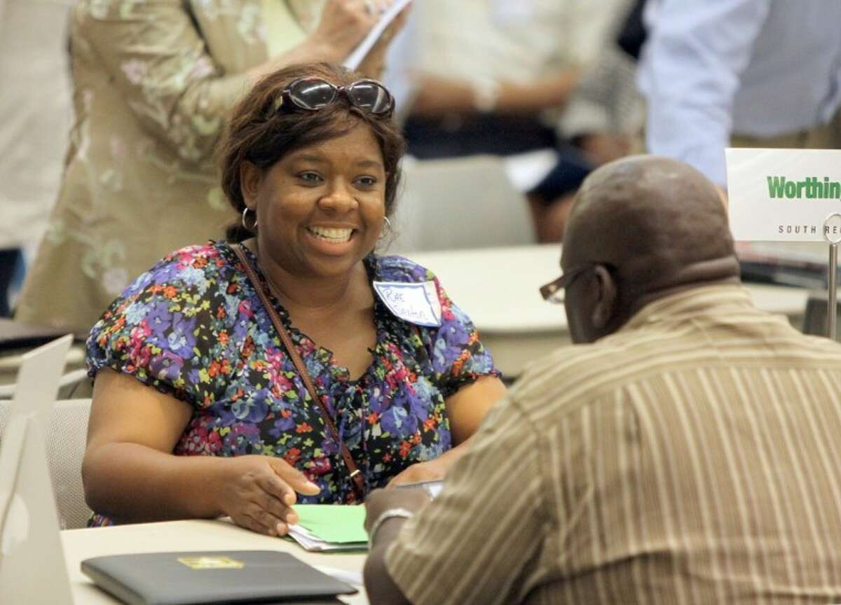 Rae Saxton interviews with Barrett Brooks, assistant principal of Worthing High School at Job Fair for Summer School Teacher Recruitment in Houston. The HISD board passed funding for the program Thursday that will help students who failed state exams to improve their performance on re-tests in July.