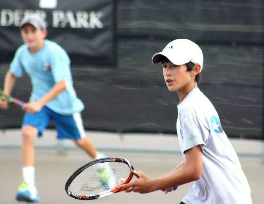 Jake Berber (at net) and doubles partner Payton Holden had to use all of their skills to get past their semifinal opponents Tuesday afternoon but the two nationally-ranked 12-year-olds prevailed. Berber is ranked 44th in the country and Holden 60th.