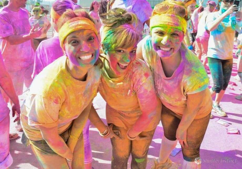Runners complete the 5K Graffiti Run drenched in color