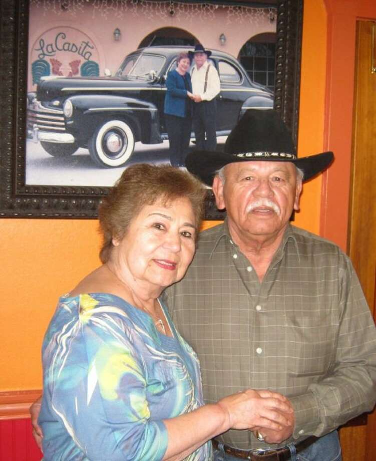 Evangelina and Paul Castillo in the lobby of their La Casita Restaurant as they prepare to celebrate their 60th Wedding Anniversary. The picture behind them was taken for their 50th Anniversary. Photo: JEFF NEWPHER