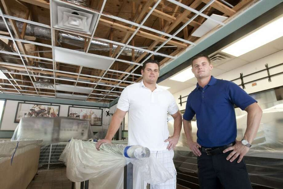 Rob Gerasimowicz Jr. and his brother Justin, shown inside the Burger King on Gosling that burned recently. The family plans to rebuild and reopen the restaurant.