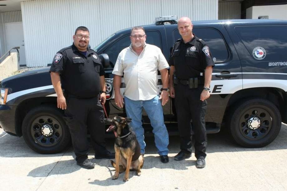 Dean Borden, center, made a generous donation to Constable Rowdy Hayden, right, and his office to purchase K-9 Dino who works with Deputy Juan Chapa.