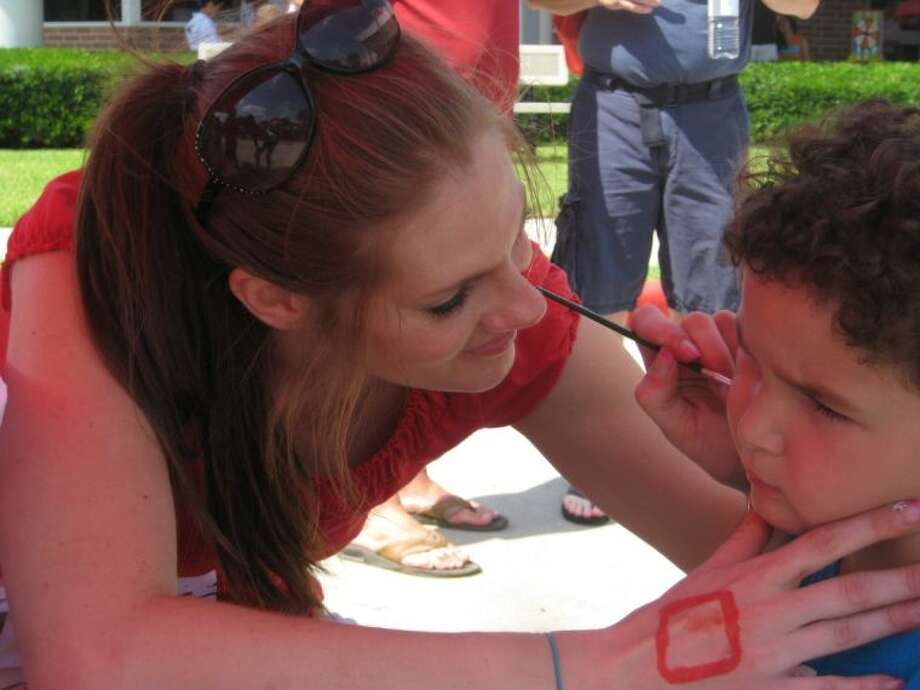 A child has his face painted during the Katy Family YMCA's Healthy Kids Day.