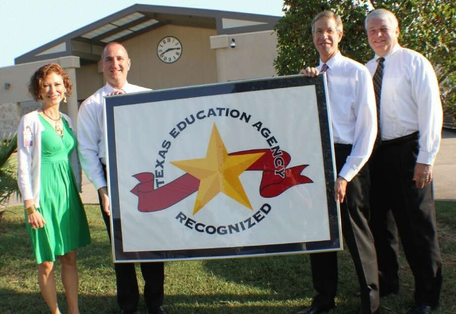 Ready to raise the banner of 'Recognized' status for the Pasadena ISD are Candace Ahlfinger, Associate Superintendent for Communications and Community Relations; Troy McCarley and Steve Laymon, both associate superintendents for campus development; and Superintendent Dr. Kirk Lewis. Photo: Courtesy Pasadena ISD
