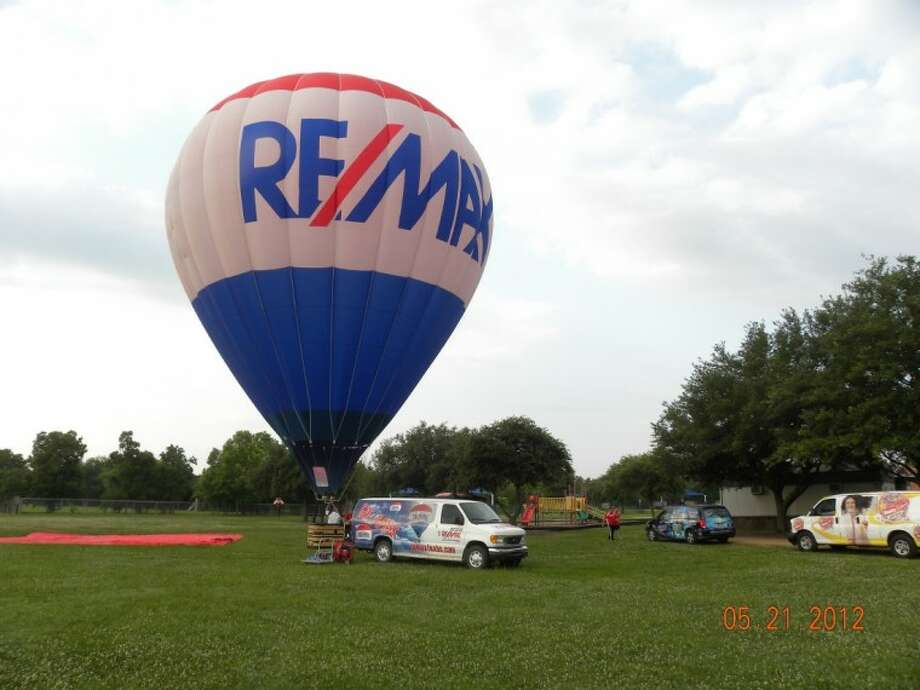"""The RE/MAX hot air balloon made a recent appearance at Cline Elementary to teach """"How Hot Air Rises"""" and Radio Disney joined in to show the importance of staying fit over the summer. Photo: Courtesy Friendswood ISD"""