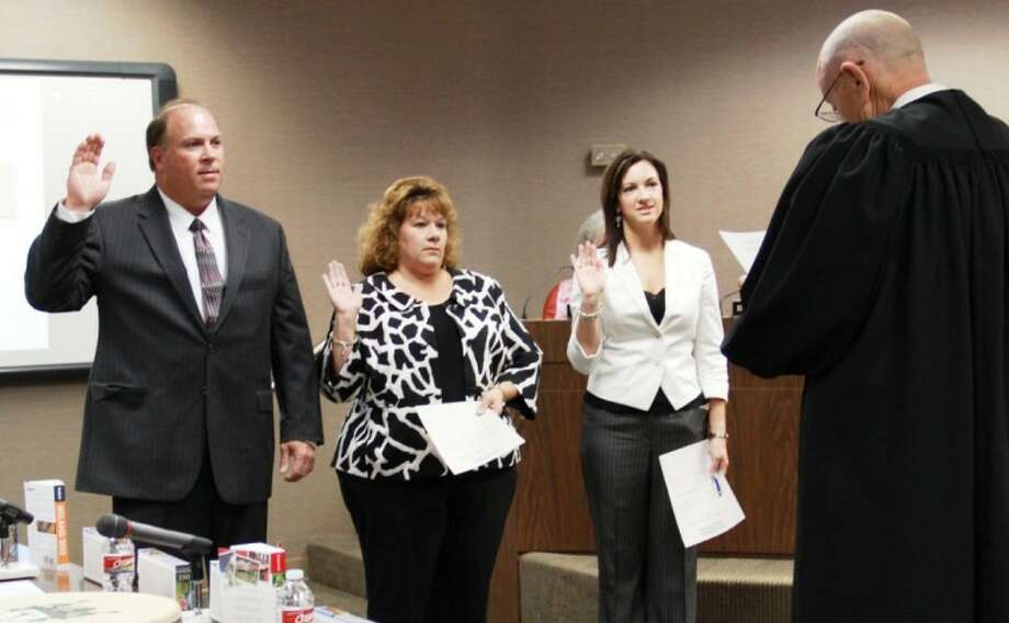 Newly elected board members Mike Lansford (position 1), Cheryl Harris (position 3), and Regan Metoyer (position 2) were sworn in at the special meeting. Harris replaces Mark Patterson, Lansford replaces Pete Vincent, while Metoyer replaces Earl Humbird. Photo: AISD