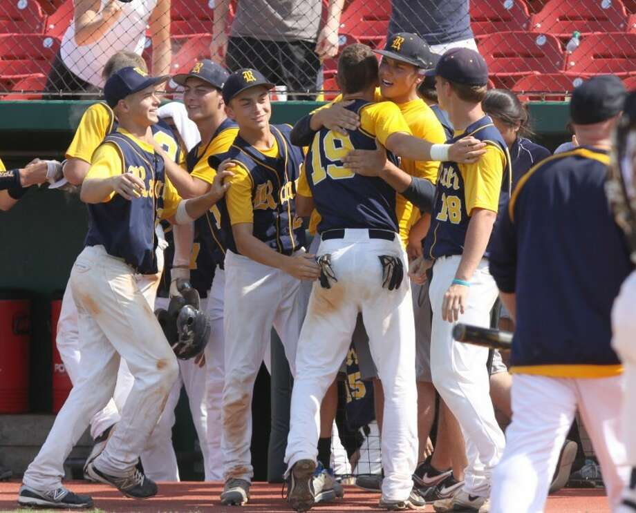 Cypress Ranch's Justin Monsour is congratulated after scoring a run against Kempner in the top of theninth inning in Game 2 at Cougar Field at the University of Houston. Cypress Ranch won the game 5-3 innine innings. (Photo by Alan Warren) Photo: Photo By Alan Warren