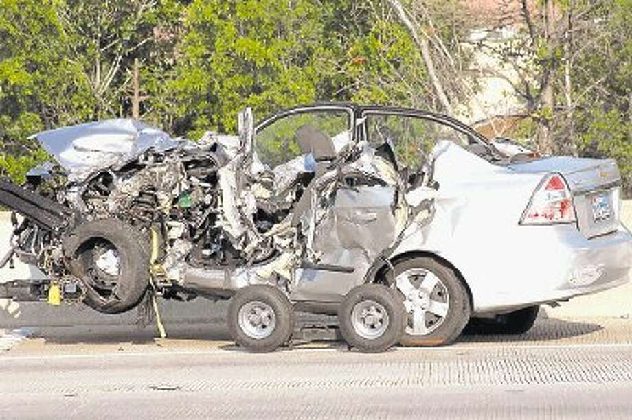 This file photo taken June 29, 2012, shows a Chevy Aveo after it had been struck, head-on, by a Ford F-150 on Interstate 45 near Texas 242. Two people were killed in the collision, Nicole Adams, the driver of the Aveo, and passenger Travis Ryan Saunders were pronounced dead at the scene.