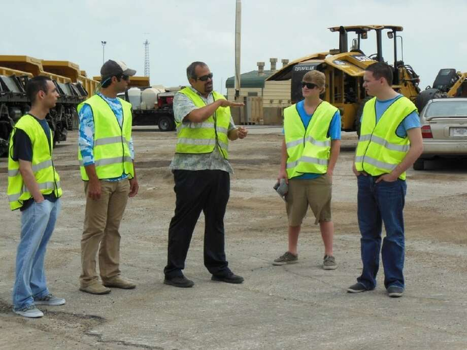 Students from the San Jacinto College South Campus' introduction to ships and shipping course listen as Mr. Tracy Murillo with Wallenius Lines explains roll-on roll-off cargo. Pictured left to right: students David Morales, Joshua Hare, Tracy Murillo (center), Steven Lair, and Robert Gillis.