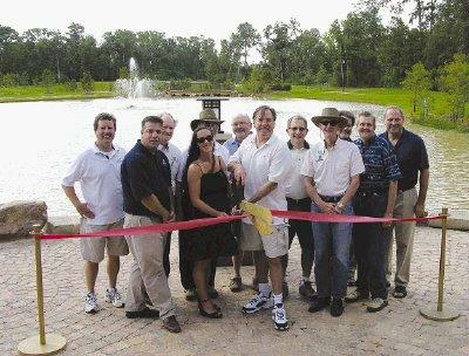 Township and community officials gathered for the official opening of Tupelo Park in The Woodlands. Pictured above, front row, left to right: Township Parks and Recreation Director Chris Nunes, Creekside Park Village President Nancy Decker-Lent, Township Chairman Bruce Tough and Township Secretary Claude Hunter. Back row, left to right: Convention and Visitors Bureau President Nick Wolda, Township Director Tom Campbell, Township Vice Chairman Lloyd Matthews, LJA Director of Planning Jim Wendt, The Woodlands Development Company Vice President of Public Affairs Joel Deretchin, Township Assistant General Manager John Powers, The Woodlands Development Company Manager of Recreation Facilities Development Bob Bruce and Township General Manager Don Norrell.
