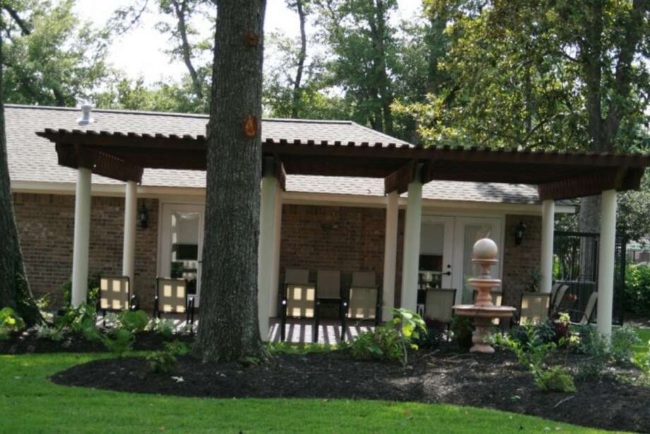 The back patio at the new Darst Funeral Home features a pergola and will include large-screen televisions and speakers so guests can hear the service from any place in the building they desire.