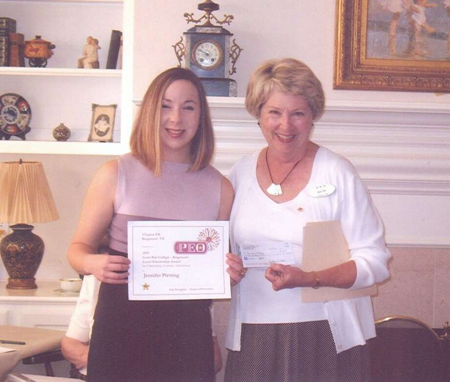 Jennifer Pletting receives a scholarship from Marie Rupp, scholarship chair for the P.E.O. Chapter FR.