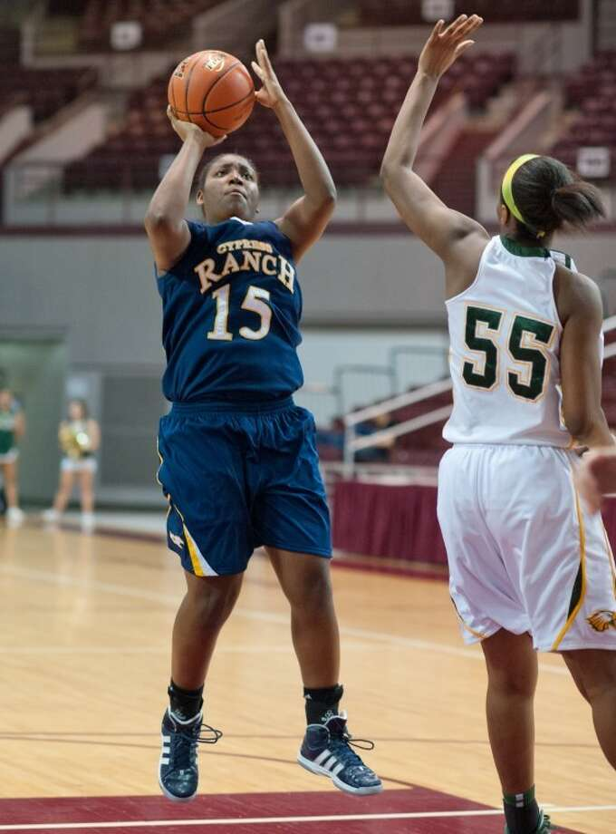 Meia Rachel tries to shoot over Carol Willie during the Region III-5A quarterfinal game between Cy Ranch and Cy Falls on Tuesday at the Campbell Center. Photo: Kevin B Long