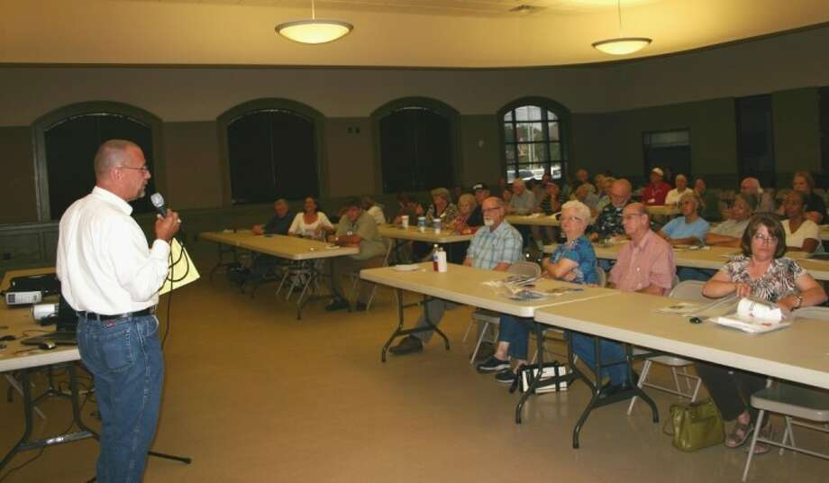 Liberty County Emergency Management Coordinator Tom Branch addresses attendees of the 2012 Public Hurricane Preparedness Workshop held June 7 at the Liberty Center. Photo: STEPHEN THOMAS