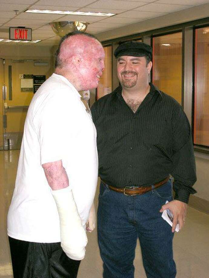 "David Joseph, a Nashville Recording artist at right, meets with ""a very special soldier, which helped me make my decision to commit and contribute to Fisher House. We met when I was invited to perform and visit at the Brook Army Medical Center in San Antonio. This young American Hero suffered 'major' burn injuries throughout his entire body."""