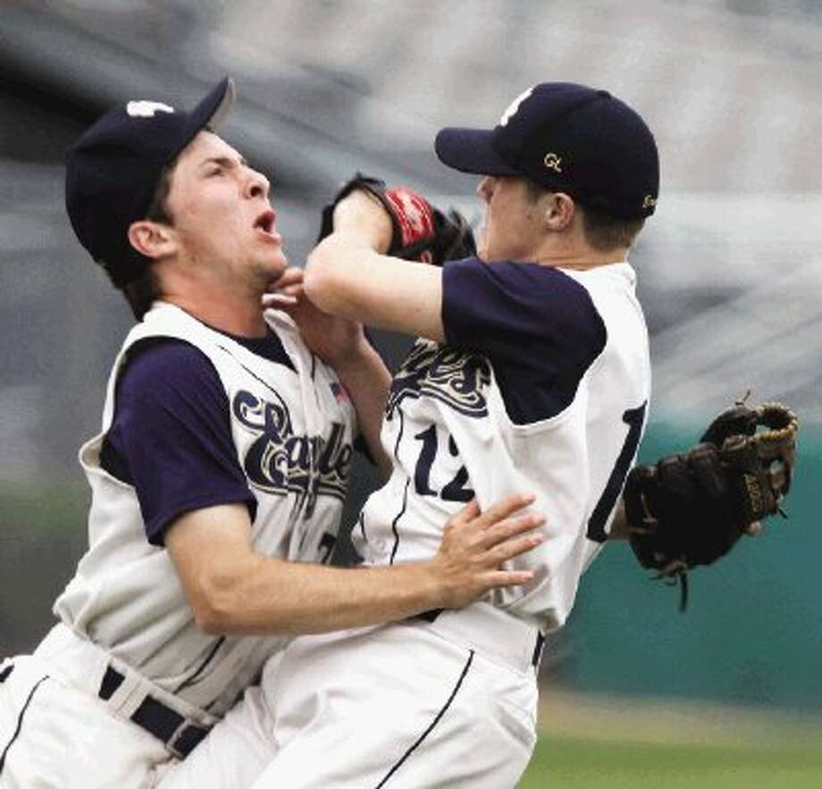 Second Baptist baseball players Reagan Czuba, left, and Travis Morland collide while trying to make a play against Kinkaid. Photo: Photo By Alan Warren / HCN