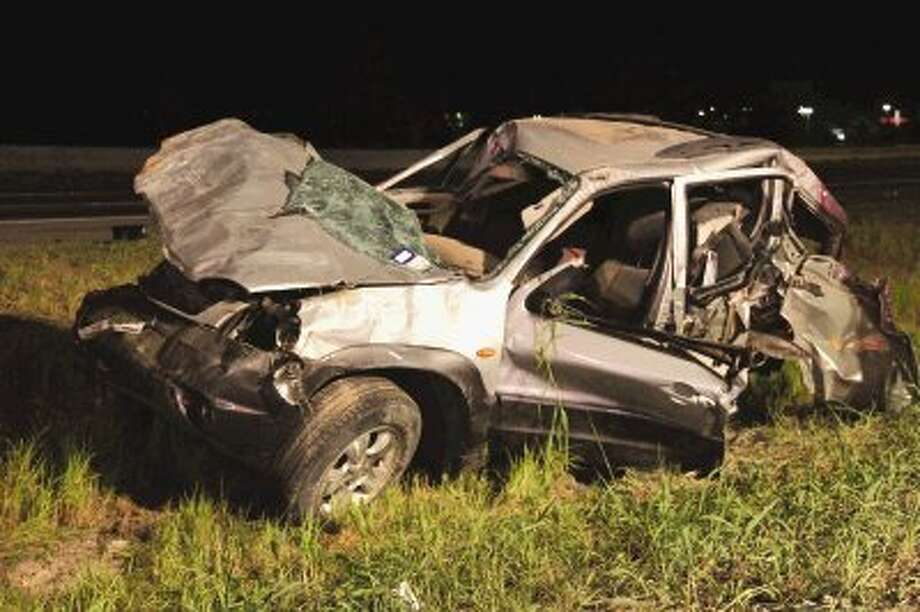 Shenandoah Police Department Lt. Bryan Carlisle said witnesses reported seeing a 2008 BMW 750 traveling at speeds in excess of a 100 mph before it struck a 2003 Mazda early Saturday morning. The driver of the Mazda was sent into multiple rollovers and became entrapped. Needham firefighters were able to extract the driver, and EMS transported her to the hospital. / James Ridgway, Jr.