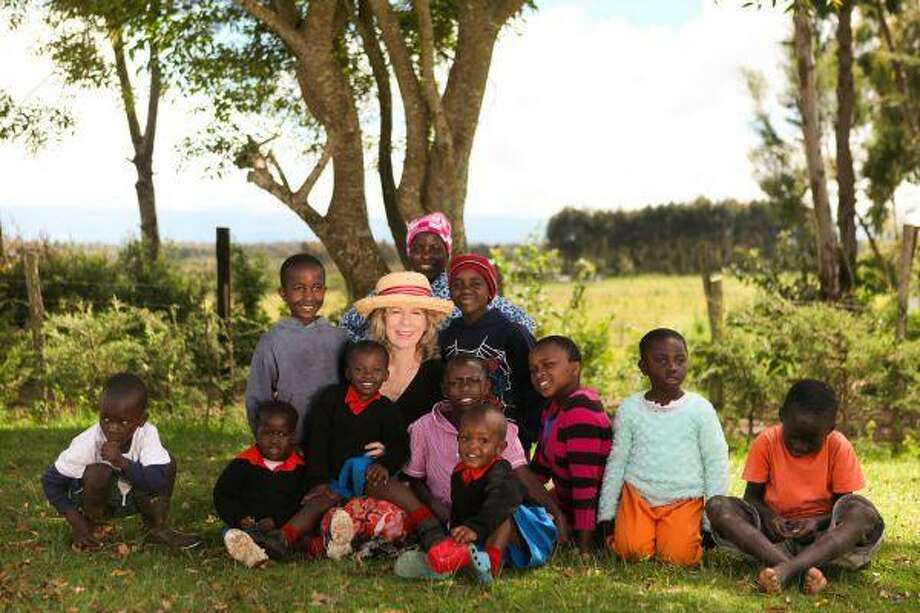 Into Abba's Arms is currently home to 30 orphans. It is founder Jane Gravis' vision, pictured in middle, to someday provide a home for 75 children.