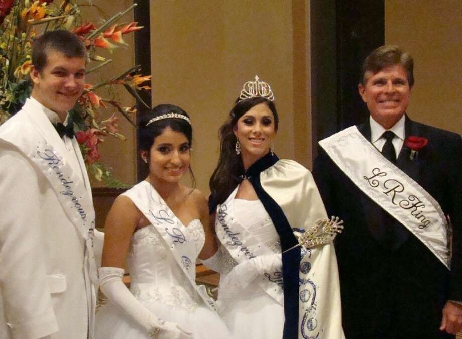 Clear Lake High senior Peyton Barrier, third from left, was crowned queen of the Lunar Rendezvous Festival Saturday night at the Coronation Ball in the Galveston Convention Center. With her are new Queen Alternate Danielle Cantu, new Captain Brooks Kubena, left, and Festival King John Wilkinsl Photo: Mary Alys Cherry
