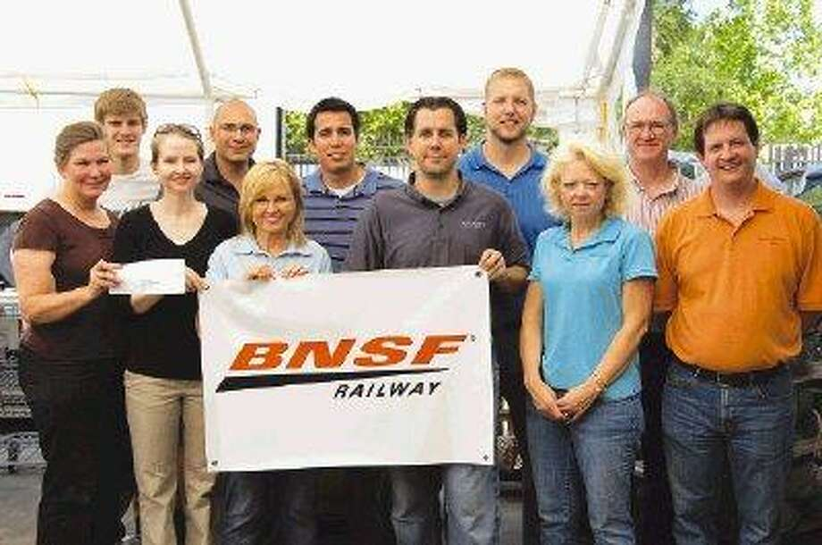 Burlington Northern Sante Fe Railway recently donated a check to the Montgomery County Food Bank. Every dollar contributes 11 pounds and five meals to a needy family in the community.