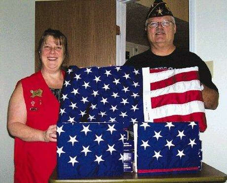 """VFW 12024 Post & Auxiliary received a phone call from Afghanistan for Help, and help they did. The call came from 1st Sgt. Glenn Wood, currently stationed in Afghanistan for U.S. flags to be flown and presented to Troops returning home from war. The emails went out to businesses, and co-workers, with a plea for support and the checks came in! With the help of American Legion Post 305, over $1,200 was collected and 95 flags were shipped to Afghanistan. """"Anytime our VFW group receives a request from one of our Soldiers, we'll do anything and everything we can to ensure that need is met. We won't let our Hero's down,"""" said Paula Ison, vice president of the Ladies Auxiliary. Pictured left to right: Paula Ison, vice president VFW 12024 Aux, Everett Ison, commander of American Legion Post 305."""