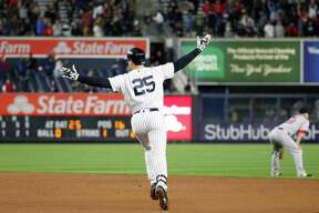 New York Yankees' Mark Teixeira (25) raises his arms in the air running the bases after hitting a ninth-inning walk-off grand slam in a baseball game against the Boston Red Sox in New York, Wednesday, Sept. 28, 2016. (AP Photo/Kathy Willens) ORG XMIT: NYY116