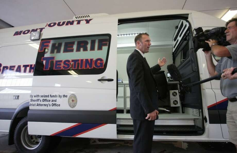 Montgomery County Assistant District Attorney Warren Diepraam is interviewed by the media about the Montgomery County Sheriff office's first Breath Alcohol Testing Mobile during a press conference unveiling the new unit Friday in Conroe. The photo was taken in September 2010. Photo: ERIC S. SWIST