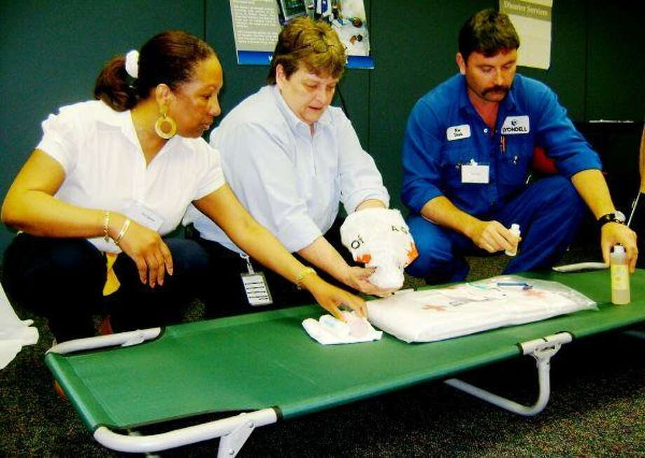 Local corporate workers get Red Cross training in advance of hurricane season.