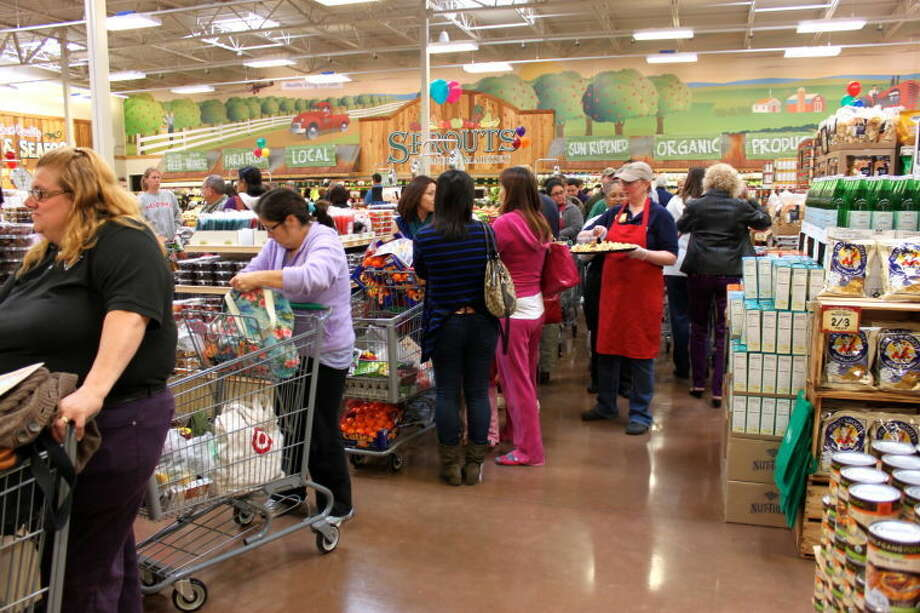 Customers wait to pay at Sprouts Farmers Market grand opening in Katy