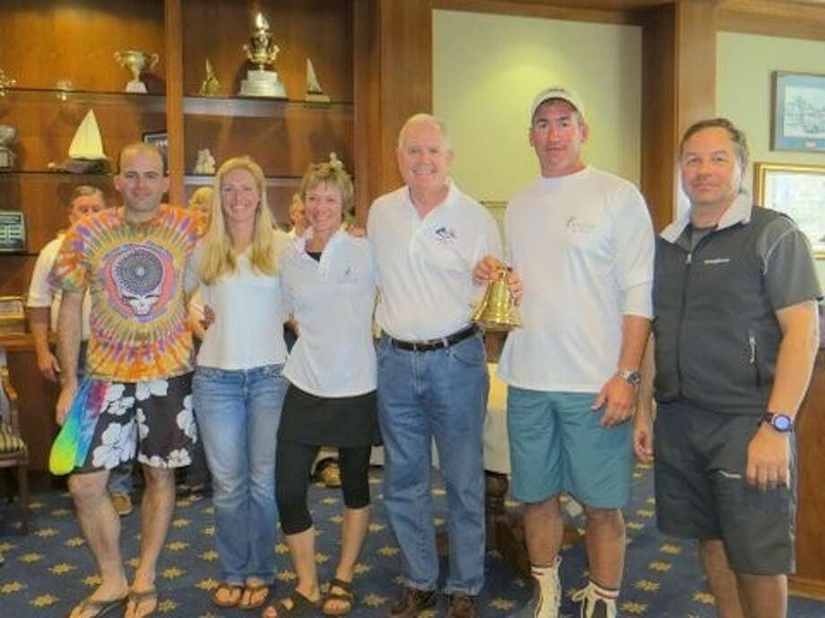 """""""Solaris"""", Bill Zartler, came in first place in the J/105 Midwinter Championship hosted by Lakewood Yacht Club on Mar. 8 - 10.Zartler is pictured second from right with the trophy and crew while Lakewood's Commodore Carl Drechsel is center, next to Zartler. Photo: SUBMITTED PHOTO"""