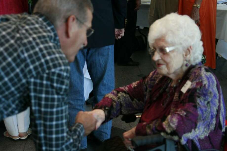 One hundred-year-old Humble High School graduate Margaret Schott talks with a guest at the 80th annual Humble High School Alumni Celebration June 9. Schott has attended every single celebration since they started in 1932.
