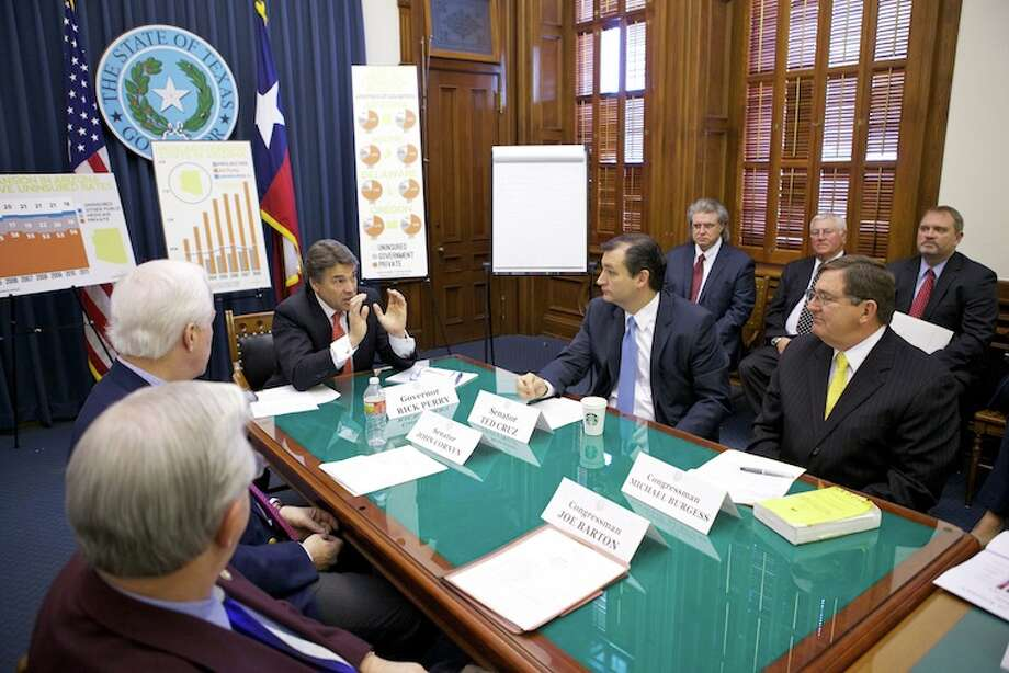 Gov. Rick Perry makes a point during a roundtable discussion in Austin. For more photos from the event, go to http://governor.state.tx.us/photos/18324.