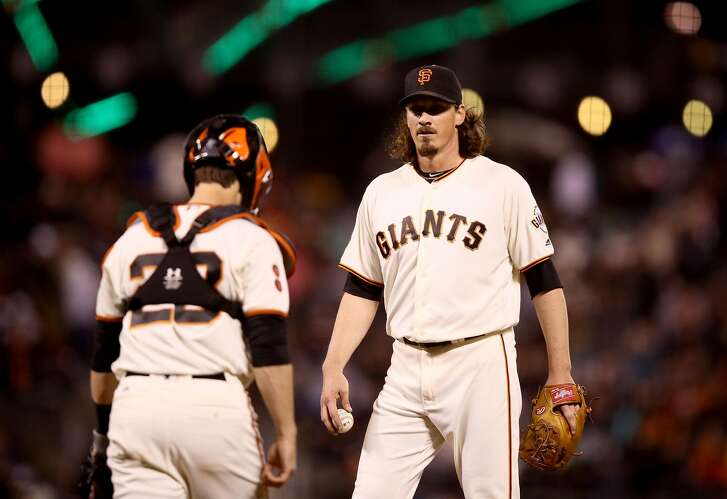 SAN FRANCISCO, CA - SEPTEMBER 28:  Buster Posey #28 comes out to talk to Jeff Samardzija #29 of the San Francisco Giants after the Colorado Rockies scored a run in seventh inning at AT&T Park on September 28, 2016 in San Francisco, California.  (Photo by Ezra Shaw/Getty Images)