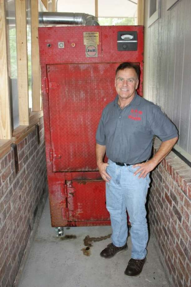 """Oscar Bozeman is ready to stoke the fire on the Little Red Smokehouse at D&M Diner in Cleveland. """"The specialty will become Texas-style barbecue,"""" he said."""