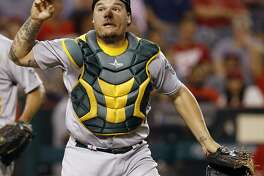 Oakland Athletics catcher Bruce Maxwell loses his grip on the ball while trying to throw out Los Angeles Angels' Jeff Bandy during the fourth inning of a baseball game in Anaheim, Calif., Wednesday, Sept. 28, 2016. Maxwell was charged with an error. (AP Photo/Alex Gallardo)