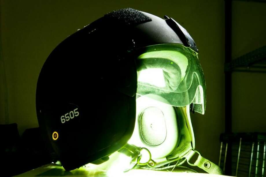 A Coast Guard flight helmet emits bright green light, similar to the light from lasers, which have continually harrassed Coast Guard pilots around the country. Laser strikes on pilots have jumped from 283 in 2005 to 3,591 in 2011, a 902 percent increase. Temporarily blinding pilots with laser lights is a federal crime. Photo: Petty Officer 2nd Class Stephen