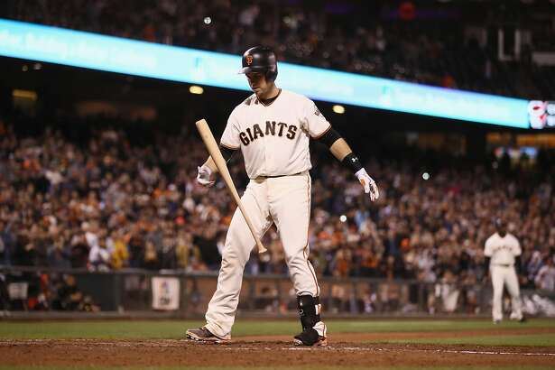 SAN FRANCISCO, CA - SEPTEMBER 28:  Buster Posey #28 of the San Francisco Giants tosses his bat in the air during his final at bat in the ninth inning against the Colorado Rockies at AT&T Park on September 28, 2016 in San Francisco, California.  Posey grounded out to end the game. (Photo by Ezra Shaw/Getty Images)