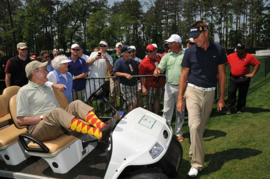 """The Shell Houston Open honors President and Mrs. George H.W. Bush on Crazy Socks Saturday, March 30, at the tournament. Golf fans who wear """"crazy socks"""" will get free prizes. Pictured at the 2012 SHO are, from left, President and Mrs. Bush and Former SHO Champions Fred Couples and Robert Allenby."""