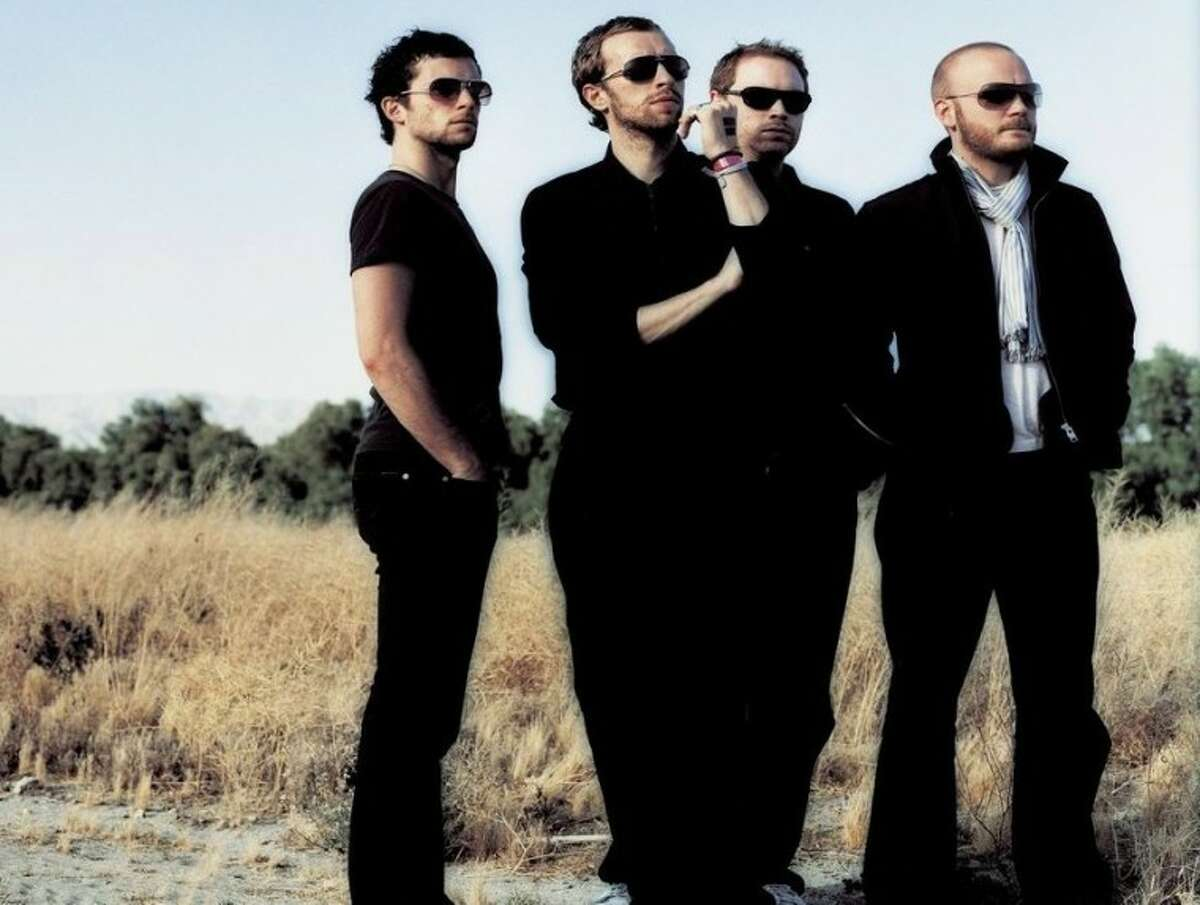 Coldplay: Four men out standing in their field.
