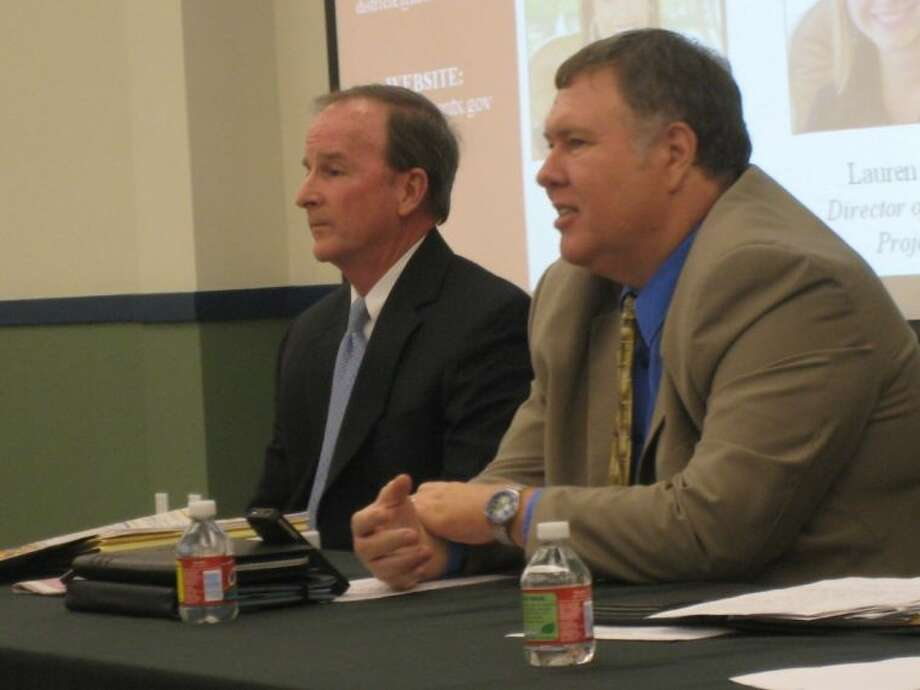 From left, City of Houston City Council Member Dave Martin and Jeff Weatherford, director of the City of Houston Public Works and Engineering, address concerns at the Kingwood Town Hall meeting.