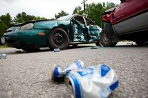 The staged accident site was littered with beer cans from the 'drunk-driver,' during the 'Forever Changed' event that took place at Tarkington High School on May 1.