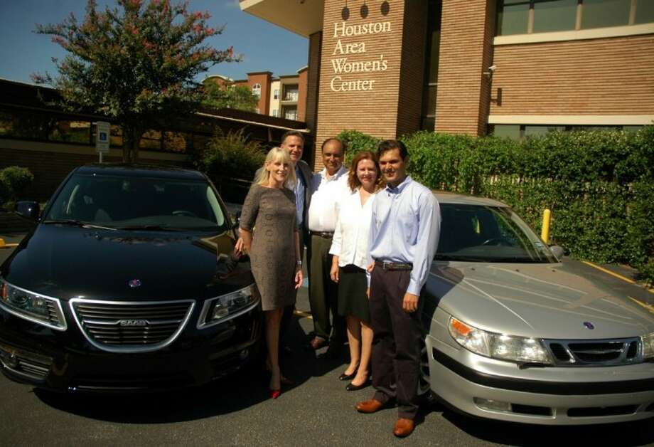 Photo by Rusty Graham/The ExaminerSebastian Gupta (right) restored a 2000 Saab 9-5 (gray car on right) raised 40,000 for the Houston Area Women's Center. He'll modify a 2011 Saab 9-5 (black car on left) for auction next year, with proceeds to benefit HAWC. With Sebastian are (from left) Rebecca White, president and CEO, HAWC; Tim Colbeck, president, Saab North America; and parents Yohanne and Linda Gupta. Photo: Rusty Graham