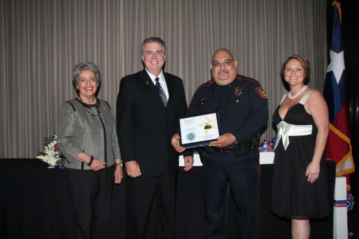 Memorial Villages Police Department Officer Oscar Miller was recently honored by the Texas-Louisiana Gulf Coast District of the National Exchange Club at their 47th Annual Crime Prevention Dinner held at the Westin Galleria. Harris County District Attorney Pat Lykos served as Mistress of Ceremonies. Officer Miller was presented by Chief Haril Walpole.For the past 47 years, the Exchange clubs in Harris, Brazoria, Fort Bend and Montgomery counties have recognized outstanding local law enforcement officers. Members of the National Exchange Club are committed to serving their communities through projects focused on Americanism, Community Service, Service to Youth, and their National Project, the Prevention of Child Abuse. Pictured from left are Lykos, Miller, Walpole and Shayla Northcutt, president of the Texas -Louisiana Gulf Coast District Exchange Clubs.