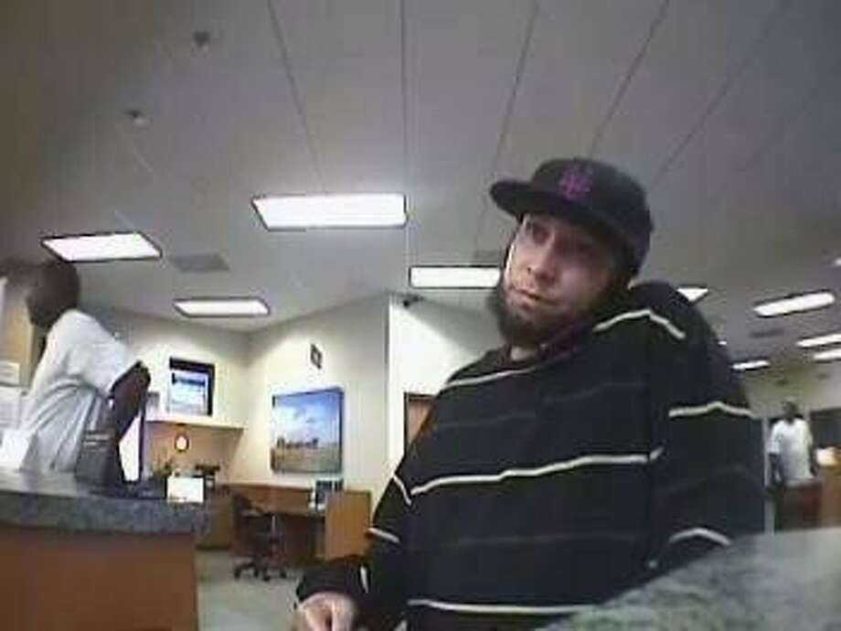 "The ""Abe Lincoln Bandit,"" pictured in this surveillance video, robbed the Wells Fargo Bank branch at 11102 Scarsdale on Saturday (June 30). Photo: Courtesy FBI"