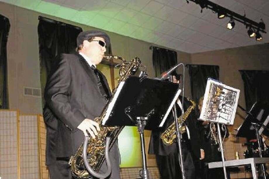 Band member Gerald Angst plays the baritone saxophone. / @WireImgId=2622674