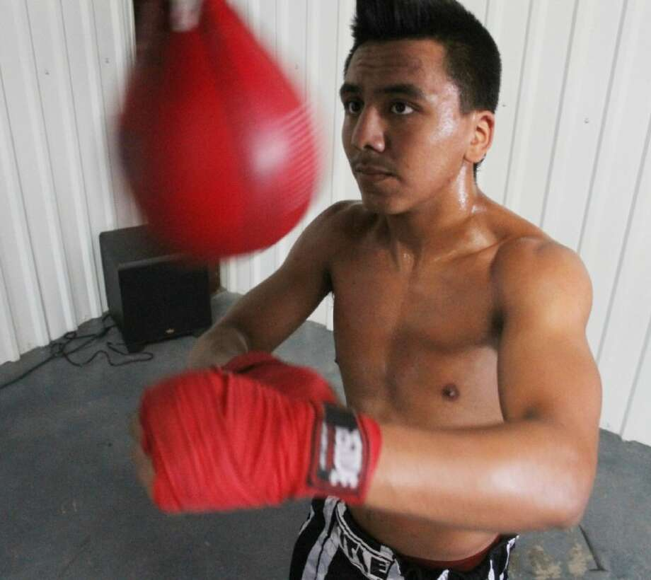 Cleveland's Luis Lopez, 17, works the bag at a Spring gym. The amateur national champion will make his pro boxing debut Sept. 22 at the Cleveland Civic Center.