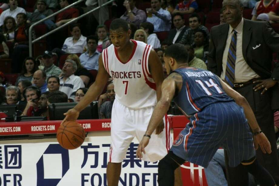 Houston Rockets guard Kyle Lowry is guarded by Charlotte Bobcats guard D.J.  Augustine a81ea88b7