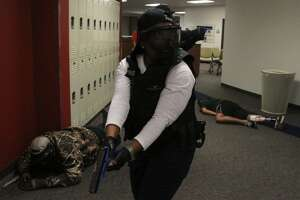 Marian Reed, a police officer with Rice University, takes part in a mock school shooting drill at Atascocita High School on July 12, 2012. Law enforcement personnel from all over the Houston and surrounding areas took part in the exercises designed to simulate a hostage event in a school setting.