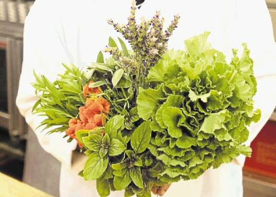 The herbs used for the specialty items and cuisine served at the Hilltop Restaurant are harvested daily for the meals that will be served. / @WireImgId=2621105