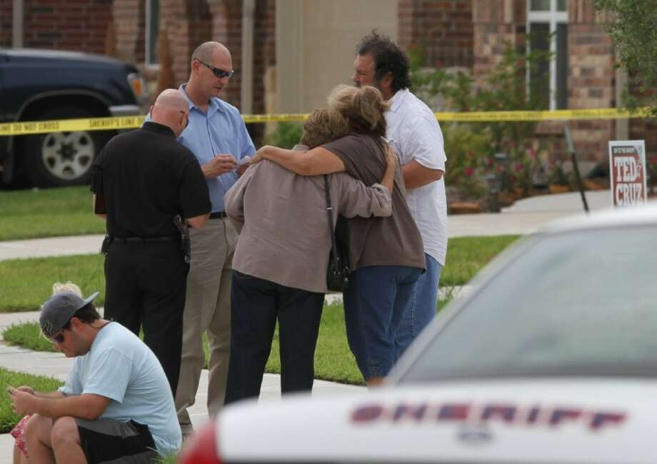 Family and friends gather on Rose Mill Dr. on the afternoon of July 11 and talk to investigators after receiving word that a man and his niece had been found deceased inside a home. The cause of the deaths is unclear at this time.